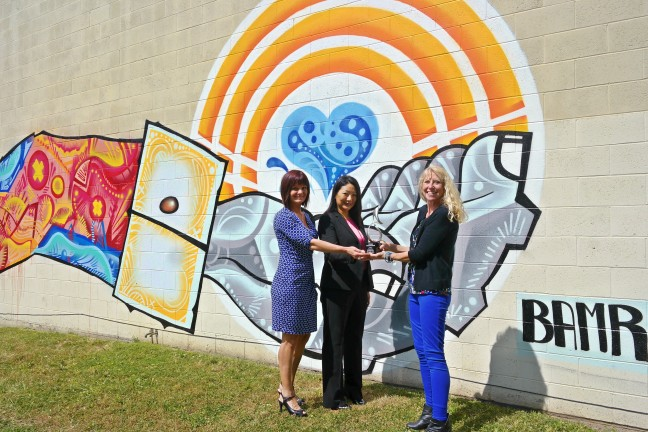 United Way presents Intel Cornerstone Award in front of new mural