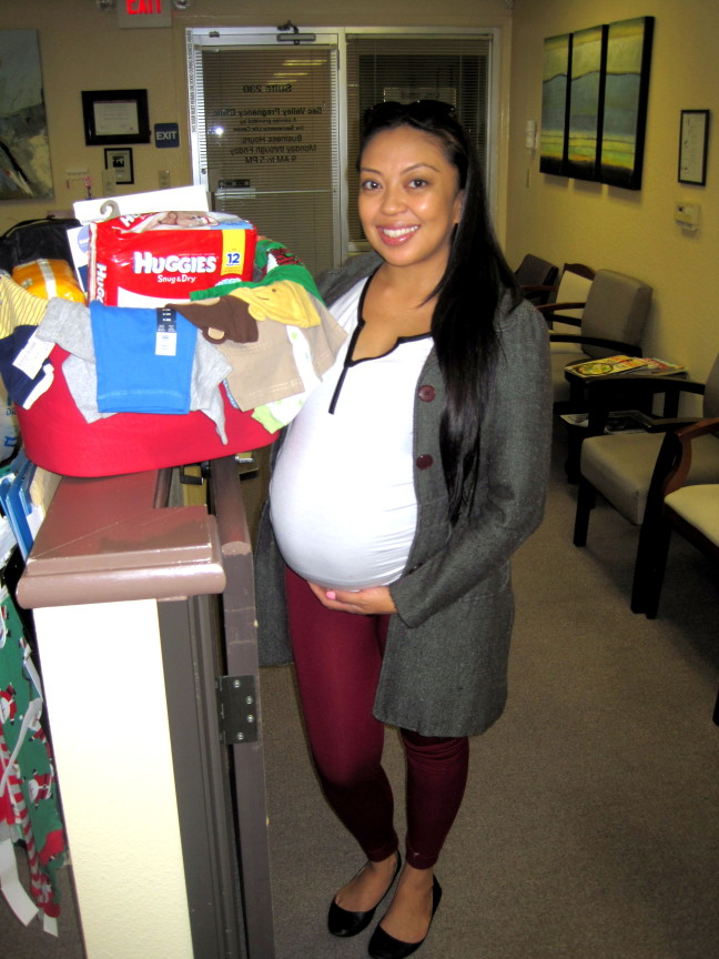 Sacramento Life Center client receives a baby basket donated by the community.