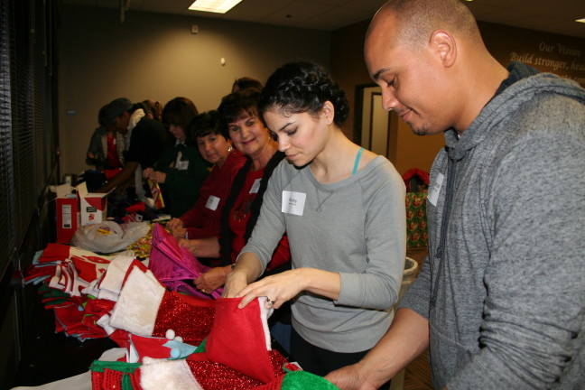 Volunteers stuff holiday stockings at United Way