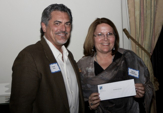 Sac Life Center receives check from American River Bank