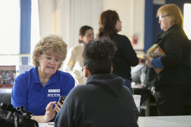 VITA volunteer helps a local resident file her taxes through United Way-led programs